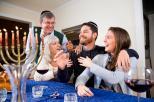 jewish-family-celebrating-chanukah-15150966